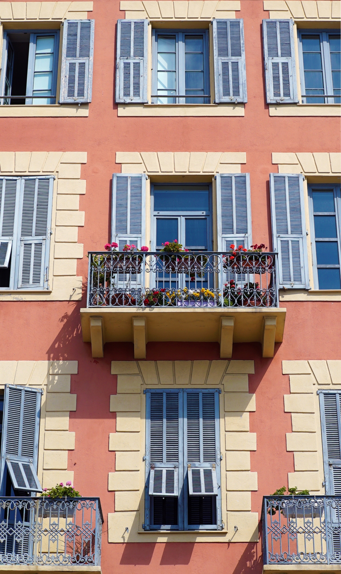 Balcony flowers pink building
