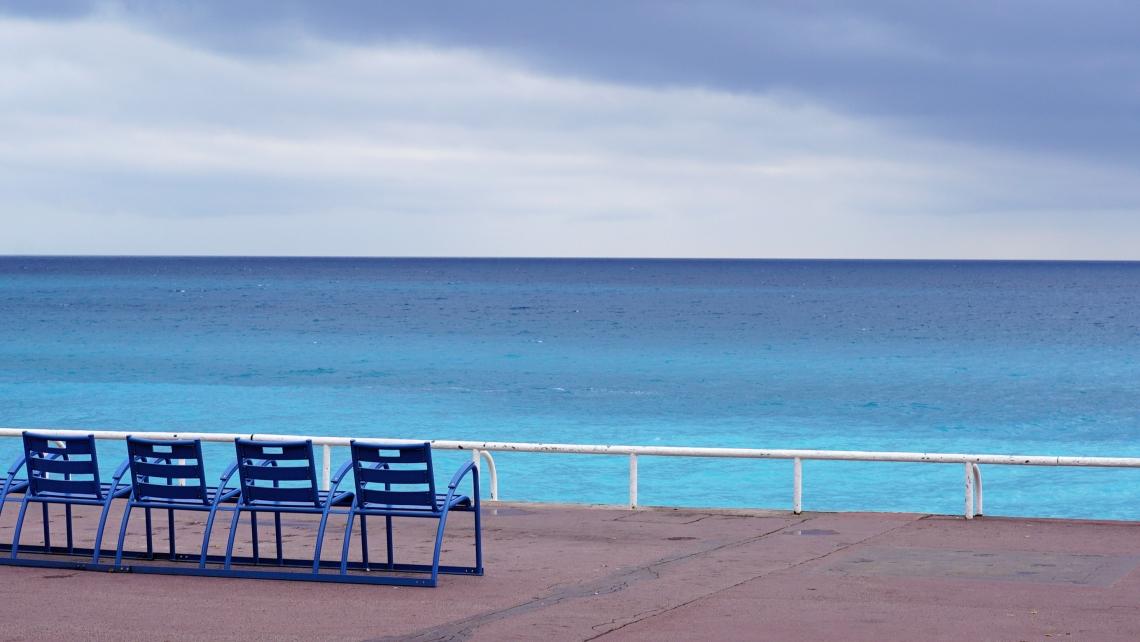Nice blue beach chairs cloudy day