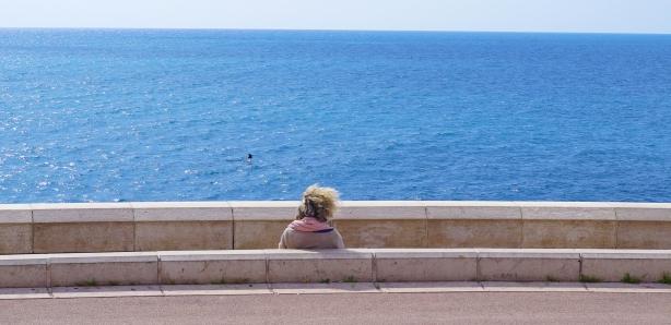 Woman alone by sea